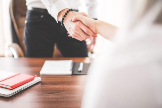 Business-man-and-woman-handshake-in-work-office_free_stock_photos_picjumbo_DSC03130-2210x1474